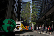 City workers pass-by an art installation entitled 'One Through Zero (The Ten Numbers)' by American pop artist Robert Indiana (b 1928), in Lime Street, City of London, the capital's Square Mile, and its financial heart.