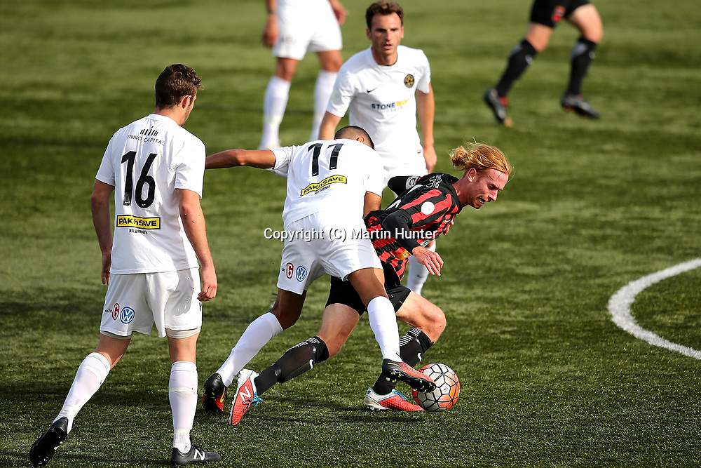 Aaron Clapham of Canterbury United is tackled by Mario Barcia of Team Wellington during the Stirling Sports Premiership match between Canterbury United and Team Wellington at English Park, Christchurch, New Zealand. Sunday 19 March 2017. ©Copyright Photo: Martin Hunter / www.photosport.nz