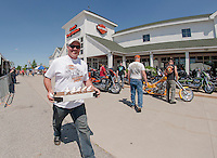 Andre Chenier of Apple Hill Canada keeps a brisk pace for ice cream delivery to his buddies at the Laconia Harley Davidson's complex on Thursday afternoon.  (Karen Bobotas/for the Laconia Daily Sun)