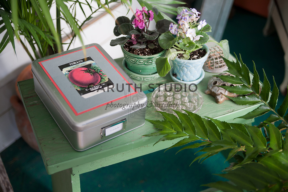 Vintage potting bench, decoupaged seed tin and collectibles detail