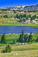 The deep blue water of Long Lake on the Beartooth Plateau in the Beartooth Mountains, Wyoming.