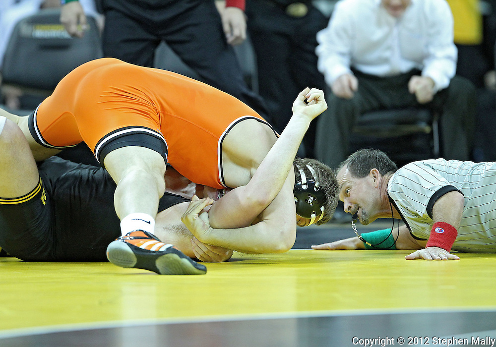 January 07, 2011: Oklahoma State's Alan Gelogaev tries to pin Iowa's Bobby Telford during the heavyweight bout in the NCAA wrestling dual between the Oklahoma State Cowboys and the Iowa Hawkeyes at Carver-Hawkeye Arena in Iowa City, Iowa on Saturday, January 7, 2012. Gelogaev won 10-2.