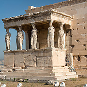 Caryatid colums on the Erechtheion, an acient greek temple on the north sideo of the Acropolis in Athens, Greece. The temple was dedicated to both Athena and Poseidon.