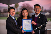 California State Assembly member Kansen Chu, right, presents MUSD Board of Trustees President Danny Lau, and SJECCD Board of Trustees President Wendy Ho with an Assembly Certificate of Recognition during the Milpitas Unified School District and San Jose Evergreen Community College District Community College Extension Ground Breaking Ceremony near Russell Middle School in Milpitas, California, on November 17, 2015. (Stan Olszewski/SOSKIphoto)