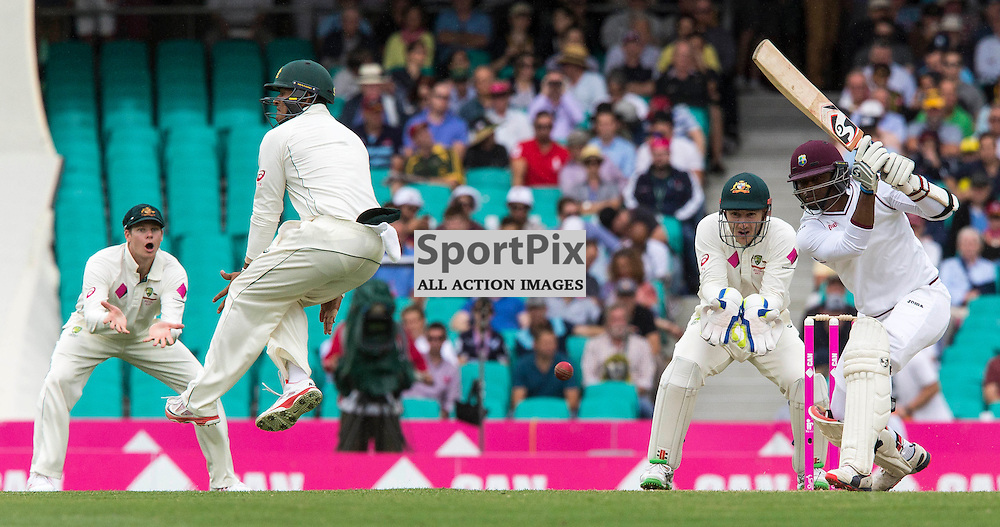 3rd Test Match 2015-16 Day 1, Australia v West Indies, Sydney Cricket Ground; 3 January 2016<br /> West Indian Marlon Samuels tries to drive a Lyon delivery as Australian Usman Khawaja jumps out of the way.
