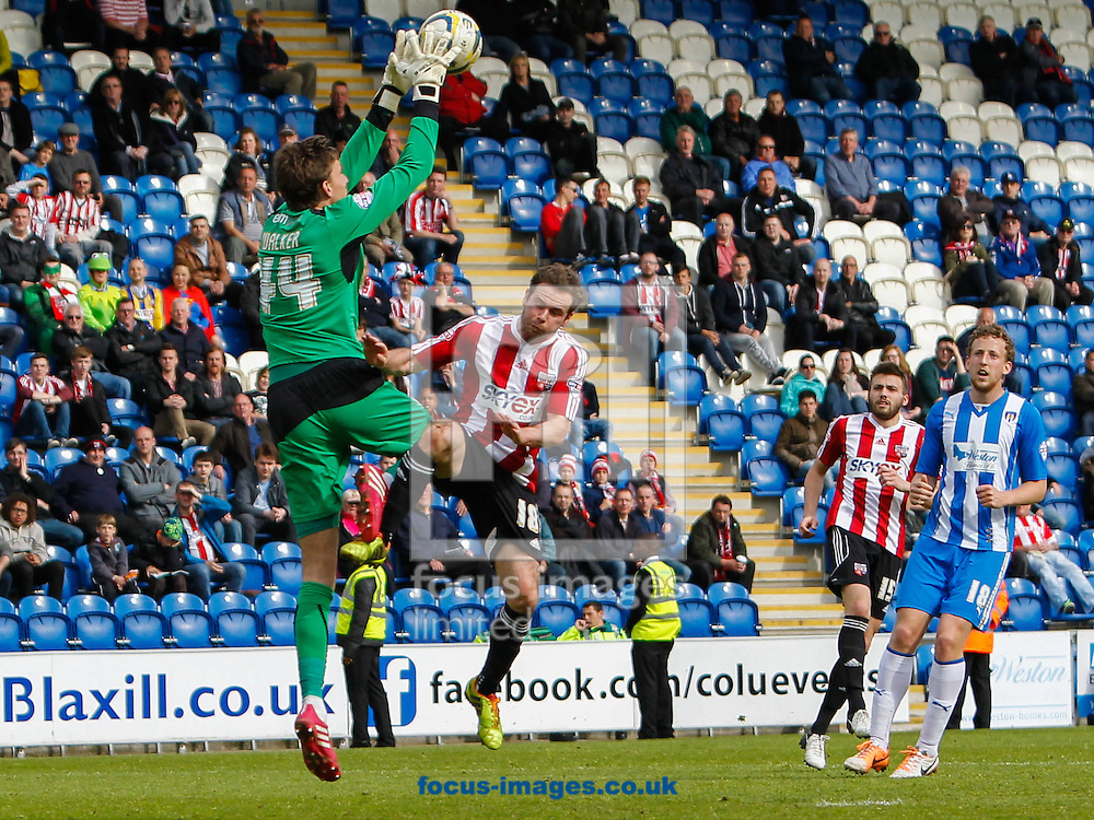 Sam Walker of Colchester United and Alan Judge of Brentford during the Sky Bet League 1 match at the Weston Homes Community Stadium, Colchester<br /> Picture by Mark D Fuller/Focus Images Ltd +44 7774 216216<br /> 26/04/2014