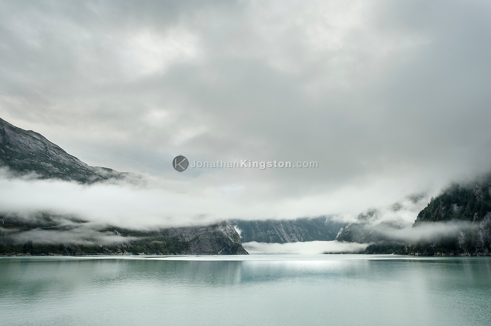 Mist shrouded cliffs of Tracy Arm Fjord, Alaska.