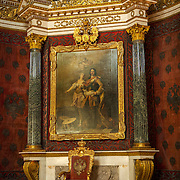 Peter the Great's memorial throne room. The Hermitage Museum also known as the Winter Palace,  was the main residence of the Russian Tsars located on the banks of the Neva River, in St. Petersburg.   Photography by Jose More