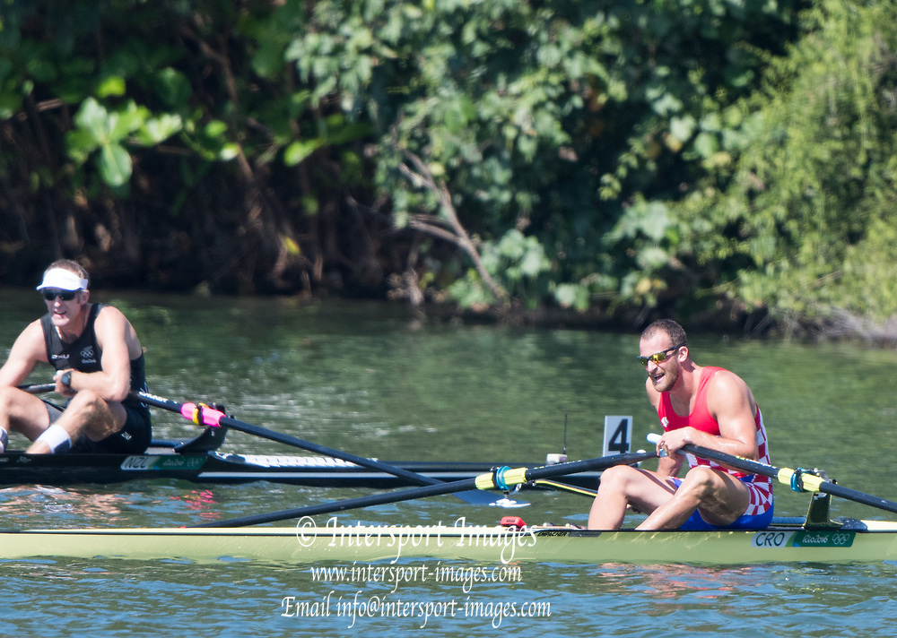 Rio de Janeiro. BRAZIL   [L] NZL. Mahe DRYSDALE and CRO M1X. Damir MARTIN     2016 Olympic Rowing Regatta. Lagoa Stadium,<br /> Copacabana,  &ldquo;Olympic Summer Games&rdquo;<br /> Rodrigo de Freitas Lagoon, Lagoa. Local Time 10:39:14  Saturday  13/08/2016<br /> [Mandatory Credit; Peter SPURRIER/Intersport Images]