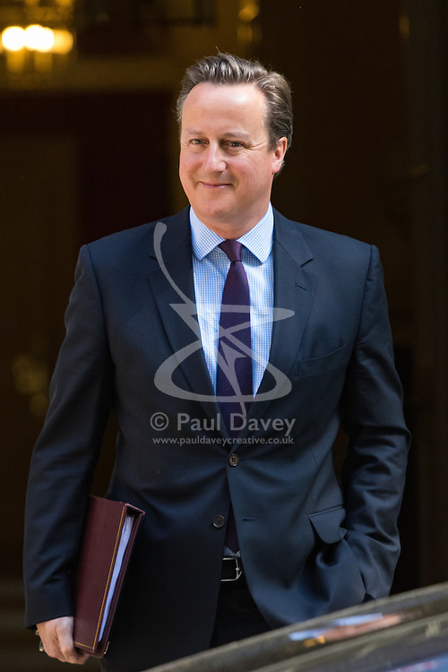 """Downing Street, London, June 6th 2016. British Prime Minister David Cameron leaves 10 Downing Street ahead of joining a cross party platform including Labour's Harriet Harman, the LibDem's Tim Farron and the Green Party's Natalie Bennett to accuse the Leave campaign of a """"con trick"""" ahead of the EU referendum."""