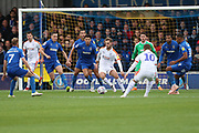 Luton Town midfielder Andrew Shinnie (11) surrounded by AFC Wimbledon players in the box during the EFL Sky Bet League 1 match between AFC Wimbledon and Luton Town at the Cherry Red Records Stadium, Kingston, England on 27 October 2018.
