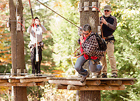 Maggie Clarke takes off for one of many zip lines during the Wounded Warriors visit to Gunstock's Aerial Treetop Adventure Rope Course on Monday afternoon.  (Karen Bobotas/for the Laconia Daily Sun)
