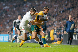 Australia replacement Quade Cooper is tackled by England Winger Jonny May - Photo mandatory by-line: Rogan Thomson/JMP - 07966 386802 - 29/11/2014 - SPORT - RUGBY UNION - London, England - Twickenham Stadium - England v Australia - QBE Autumn Internationals.