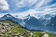 Schreckhorn (in middle) and Finsteraarhorn (middle right) rise impressively above Grindelwald, in Switzerland, the Alps, Europe. The Finsteraarhorn (4274 m / 14,022 ft) is the highest mountain in the Bernese Alps and the most prominent peak of Switzerland (in terms of the lowest topographic contour at the mountain's base). The Schreckhorn (4078 m / 13,379 ft) is the northernmost summit rising above 4000 meters in Europe. This whole massif and surrounding glaciers were designated as part of UNESCO's Jungfrau-Aletsch World Heritage Site.
