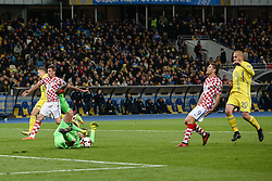 October 9, 2017 - Kiev, Ukraine - Croatian player Andrej Kramaric, vies Ukrainian defender Yaroslav Rakitskiy and  goalkeeper Andriy Pyatov of Ukraine  during the FIFA 2018 World Cup Group I Qualifier between Ukraine and Croatia at Kiev Olympic Stadium on October 9, 2017 in Kiev, Ukraine. Ukraine fail to reach the play-offs as they lose 2-0. (Credit Image: © Sergii Kharchenko/NurPhoto via ZUMA Press)
