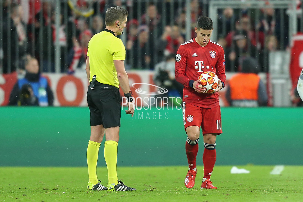 Bayern Munich midfielder James Rodriguez (11) looking to place a free-kick during the Champions League match between Bayern Munich and Liverpool at the Allianz Arena, Munich, Germany, on 13 March 2019.