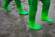 "Visitors with hip long rubber boots on the open ""Mysterious Sea Road"" at Hoedong shore (Jindo island). Jindo is the 3rd biggest island in South Korea located in the South-West end of the country and famous for the ""Mysterious Sea Route"" or ""Moses Miracle"". Every spring thousands flock to the shores of Jindo to walk the mysterious route that stretches roughly three kilometers from Hoedong to the distant island of Modo. Materializing from the rise and fall of the tides, the divide can reach as wide as forty meters."