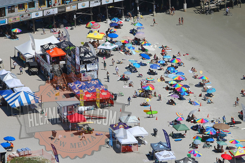 An aerial view of the contest area during the 28th annual National Kidney Foundation, Rich Salick Pro/Am surf festival takes place at the the Cocoa Beach pier on Saturday,  September 2, 2013 in Cocoa Beach, Florida. This event raises thousands of dollars for people with kidney disease and also benefits the services of the NKF of Florida. (AP Photo/Alex Menendez)