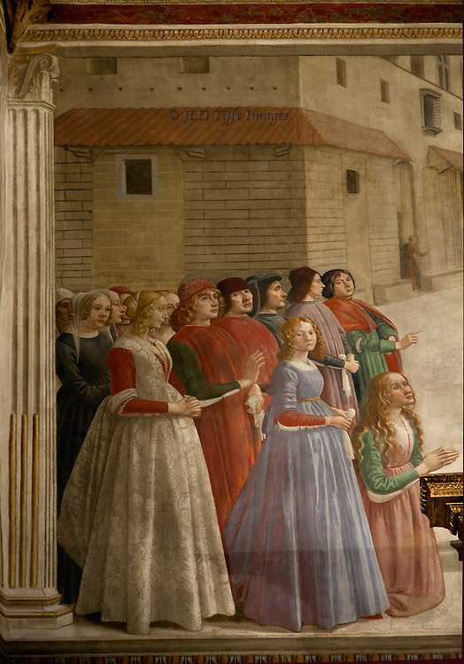 Sassetti chapel in Santa Trinita with frescoes by Domenico Ghirlandaio of the Life of St. Francis, 1483-86.  Four or five well dressed ladies in the foreground, male escorts behind.