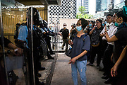 A woman confronts the police as protesters occupy a bridge in front of the Central Government Offices, during a protest against a proposed extradition law in Hong Kong, SAR China, on Wednesday, June 12, 2019. Hong Kong's legislative chief postponed the debate on legislation that would allow extraditions to China after thousands of protesters converged outside the chamber demanding the government to withdraw the bill. Photo by Suzanne Lee/PANOS