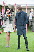 Kaya Scodelario; Elliott Tittensor, Cartier Queen's Cup. Guards Polo Club, Windsor Great Park. 17 June 2012