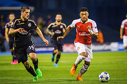 Arijan Ademi #16 of GNK Dinamo Zagreb vs Alex Oxlade-Chamberlain #15 of Arsenal F.C. during football match between GNK Dinamo Zagreb, CRO and Arsenal FC, ENG in Group F of Group Stage of UEFA Champions League 2015/16, on September 16, 2015 in Stadium Maksimir, Zagreb, Croatia. Photo by Ziga Zupan / Sportida