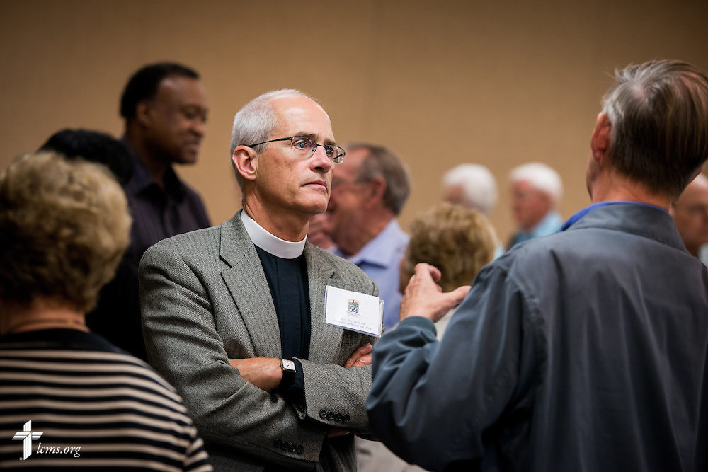 The Rev. Steven Briel, Chairman of Board for the LCMS Office of National Mission, chats with a participant during The 72 Witness & Outreach Team Training on Thursday, Sept. 11, 2014, at the National Shrine of Our Lady of the Snows in Belleville, Ill. LCMS Communications/Erik M. Lunsford