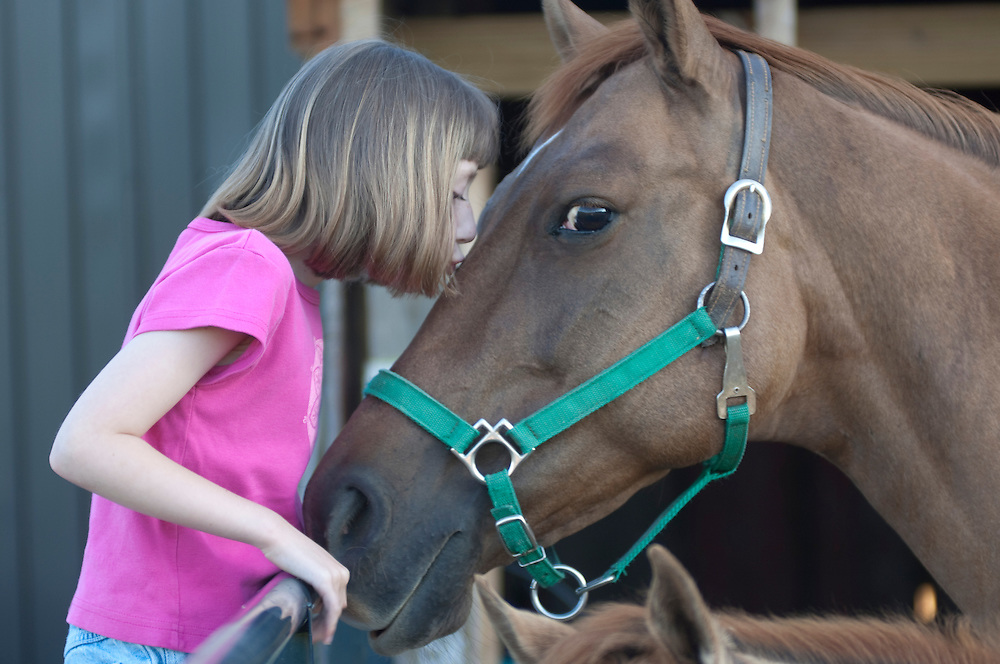 Young girl with horse