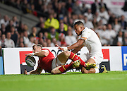 Wales centre Scott Williams gets to the ball on the try line ahead of England wing Anthony Watson during the Rugby World Cup Pool A match between England and Wales at Twickenham, Richmond, United Kingdom on 26 September 2015. Photo by David Charbit.