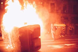 October 1, 2018 - Barcelona, Catalonia, Spain - Protesters face the police in the streets of barcelona on the evening of the anniversary of the one year referendum of October 1st. (Credit Image: © Pierre Berthuel/Le Pictorium Agency via ZUMA Press)