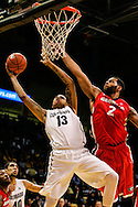 December 28th, 2013:  Colorado Buffaloes freshman forward Dustin Thomas (13) puts a shot up against Georgia Bulldogs redshirt junior forward Marcus Thornton (2) in the second half of the NCAA Basketball game between the Georgia Bulldogs and the University of Colorado Buffaloes at the Coors Events Center in Boulder, Colorado
