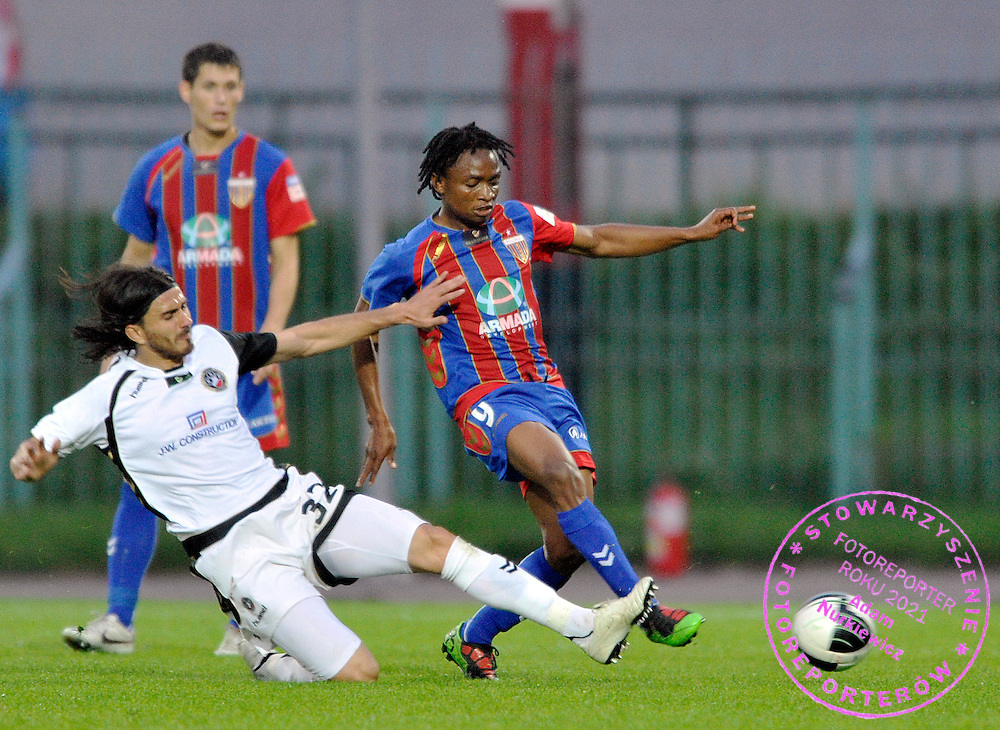 (L) PATRYK RACHWAL (WARSAW) & (R) CLEMENCE MATAWU (BYTOM) FIGHT FOR THE BALL DURING 7. ROUND SEASON 2010/2011 EXTRALEAGUE SOCCER MATCH BETWEEN POLONIA WARSAW AND POLONIA BYTOM AT POLONIA'S STADIUM IN WARSAW...WARSAW , POLAND , SEPTEMBER 25, 2010..( PHOTO BY ADAM NURKIEWICZ / MEDIASPORT )