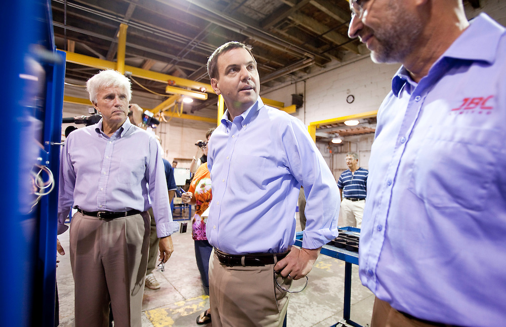 Ontario PC leader Tim Hudak, center, talks to workers during a campaign stop at J.B. Coatings in Chatham Ontario, Tuesday, September 13, 2011.<br /> THE CANADIAN PRESS/ Geoff Robins