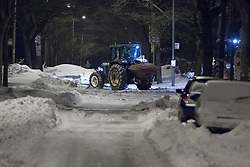 © Licensed to London News Pictures . 24/03/2013 . Burnley , UK . A snow plough cum gritter clearing the way on Halifax Road . Snowdrifts are making roads impassable around Burnley overnight (23rd/24th March) as high winds blow snow across roads . Plummeting temperatures and treacherous conditions are reported to have taken the life of a man named locally as Gary Windle . Lancashire Police reported finding a 27 year old man dead in deep snow yesterday (23rd March) afternoon . Photo credit : Joel Goodman/LNP