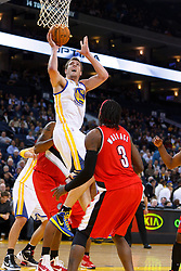 Jan 25, 2012; Oakland, CA, USA; Golden State Warriors power forward David Lee (10) shoots in front of Portland Trail Blazers small forward Gerald Wallace (3) during the first quarter at Oracle Arena. Golden State defeated Portland 101-93. Mandatory Credit: Jason O. Watson-US PRESSWIRE
