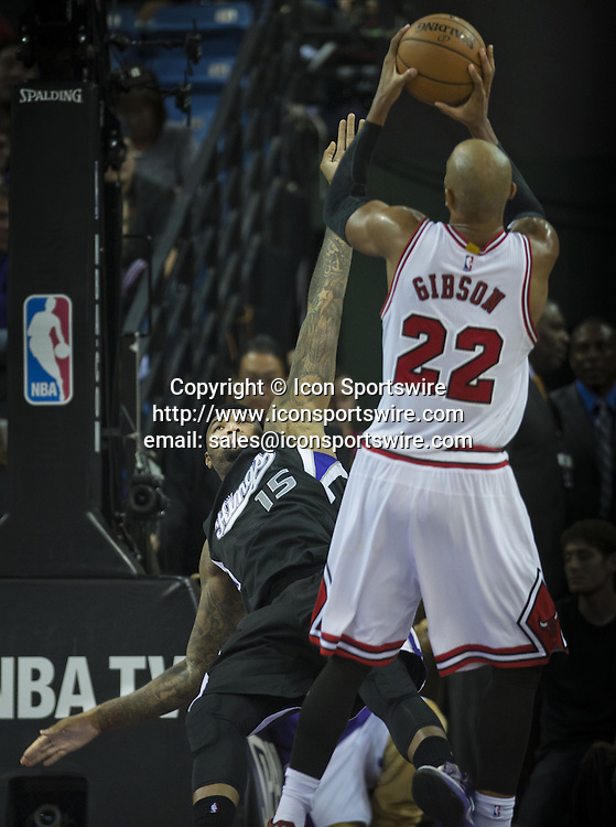 Nov. 20, 2014 - Sacramento, CA, USA - The Sacramento Kings' DeMarcus Cousins (15) falls after he is fouled by the Chicago Bulls' Taj Gibson (22) in the first half on Thursday, Nov. 20, 2014, at Sleep Train Arena in Sacramento, Calif