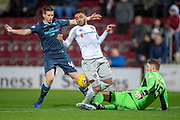Conor Hazard (#15) of Partick Thistle FC gives away a penalty as he tackles Jake Mulraney (#23) of Heart of Midlothian during the William Hill Scottish Cup quarter final replay match between Heart of Midlothian and Partick Thistle at Tynecastle Stadium, Gorgie, Edinburgh Scotland on 12 March 2019.