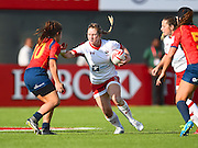 Canadian Sara Kaljuvee stiff arms a Spanish defender during the Emirates Dubai rugby sevens match between Canada and Spain  at the Sevens Stadium, Al Ain Road, United Arab Emirates on 1 December 2016. Photo by Ian  Muir.*** during the Emirates Dubai rugby sevens match between *** and ***  at the Sevens Stadium, Al Ain Road, United Arab Emirates on 1 December 2016. Photo by Ian  Muir.