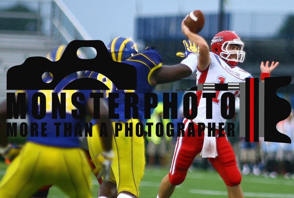 Delaware State Quarterback Nick Elko #12 attempts to throw a pass in the pocket during a Week 2 NCAA football game against Delaware Saturday Sept. 08, 2012 in Newark Delaware.