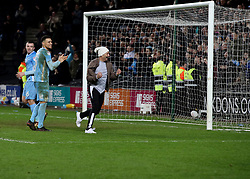 Coventry City's Maxime Biamou celebrates with a fan after the final whistle of the Emirates FA Cup  Fourth Round match at  Stadium MK Milton Keynes.
