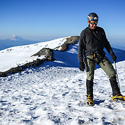 Climber Michael Naiman looks down at the highest point of Mount Rainier during a summit of Mount Rainier on June 30, 2015. The iconic Pacific Northwest volcano is a popular challenge for mountaineers.  (Joshua Trujillo, seattlepi.com)