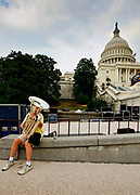 A tuba player outside the US Capitol Building on Capitol Hill. The Congress Building is divided into the Senate and the House.