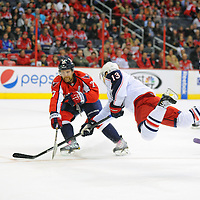 19 October 2013:  Columbus Blue Jackets right wing Cam Atkinson (13) is tripped as he goes to the net in action against the Washington Capitals at the Verizon Center in Washington, D.C. where the Washington Capitals defeated the Columbus Blue Jackets, 4-1.