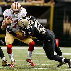 Nov 9, 2014; New Orleans, LA, USA; San Francisco 49ers quarterback Colin Kaepernick (7) is sacked by New Orleans Saints inside linebacker Ramon Humber (53) during overtime of a game at Mercedes-Benz Superdome. The 49ers defeated the Saints 27-24 in overtime. Mandatory Credit: Derick E. Hingle-USA TODAY Sports