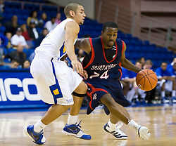 November 30, 2009; San Jose, CA, USA;  Saint Mary's Gaels guard Wayne Hunter (24) is guarded by San Jose State Spartans guard Adrian Oliver (2) during the second half at the Event Center Arena.  Saint Mary's defeated San Jose State 78-71.