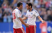 FUSSBALL   1. BUNDESLIGA   SAISON 2013/2014   4. SPIELTAG Hamburger SV - Eintracht Braunschweig                  31.08.2013 Tolgay Arslan und Hakan Calhanoglu (v.l., beide Hamburger SV) freuen sich nach dem 4:0