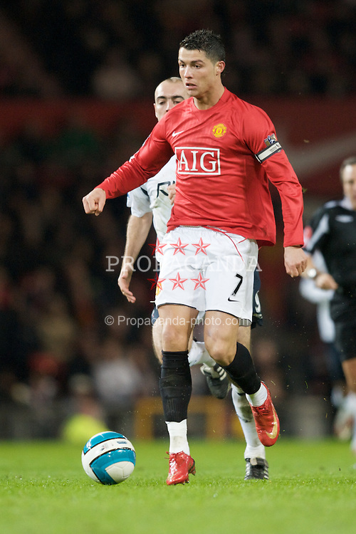 MANCHESTER, ENGLAND - Wednesday, March 19, 2008: Manchester United's Cristiano Ronaldo in action against Bolton Wanderers during the Premiership match at Old Trafford. (Photo by David Rawcliffe/Propaganda)