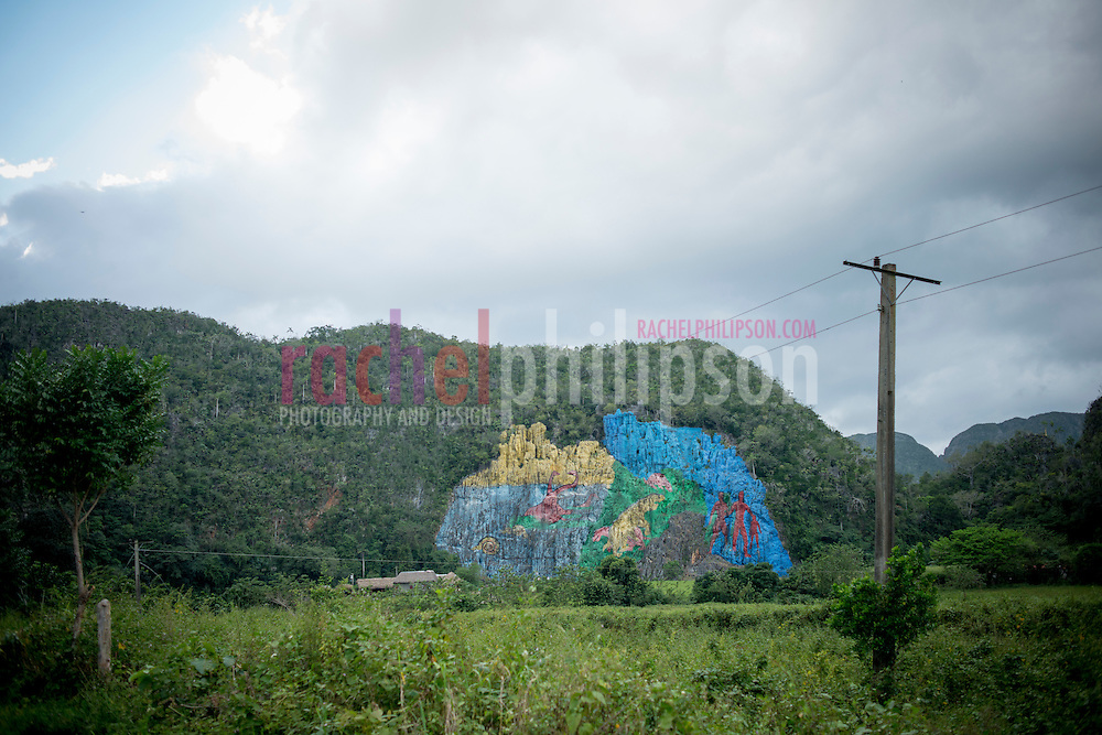 Cuba, Viñales, landscape, mountain view, signs, The Viñales Mural de la Prehistoria is the work of the former Director of Mapping at the Cuban Academy of Sciences, Leovigildo González Morillo