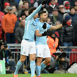 Sergio Aguero of Manchester City celebrates scoring a goal with Leroy Sane of Manchester City