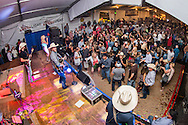Dancing and live music with Chancey Williams and the Younger Brothers Band a the Buckin' A Saloon at Cheyenne Frontier Days Rodeo in Cheyenne, WY.